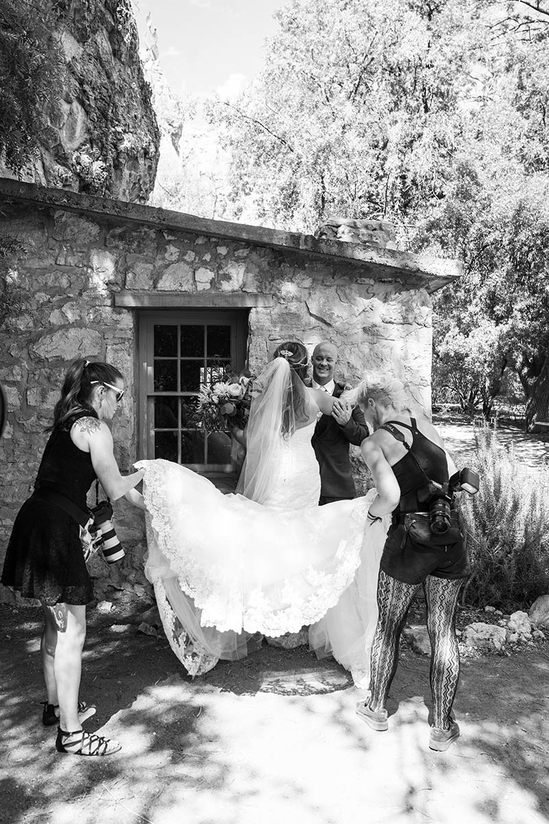 Behind the scenes: adjusting the bride's dress